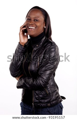 Gorgeous young woman chatting on her mobile phone. - stock photo