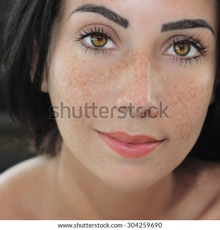 Gorgeous young woman closeup portrait. Beauty portrait of pretty young woman with freckles - stock photo