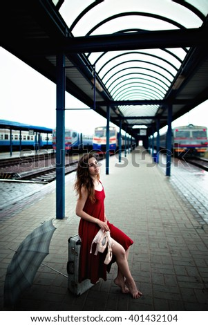 gorgeous young  woman spends time at the station - stock photo