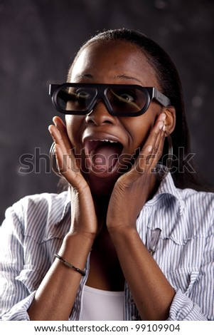Gorgeous young woman watching a 3D movie, with 3D glasses on. - stock photo