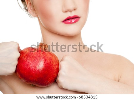 Gorgeous young woman wearing colorful make-up with Pomegranate