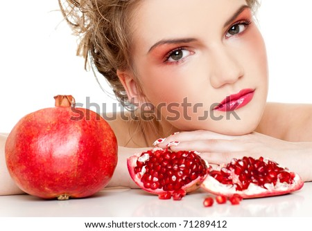 Gorgeous young woman wearing colorful makeup with Pomegranate