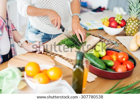 Gorgeous young Women preparing dinner in a kitchen concept cooking, culinary, healthy lifestyle - stock photo