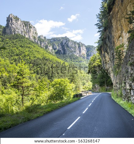 Gorges du Tarn (Lozere, Linguedoc-Roussillon, France), famous canyon at summer. The road and the mountains.