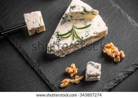 Gorgonzola cheese on black background  - stock photo