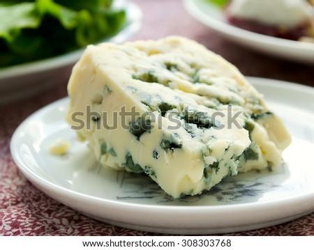 gorgonzola cheese on white plate, Italian food - stock photo