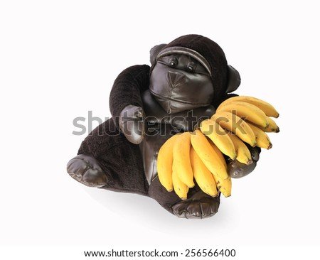 Gorilla with a banana  isolated on white background  this has clipping path. - stock photo