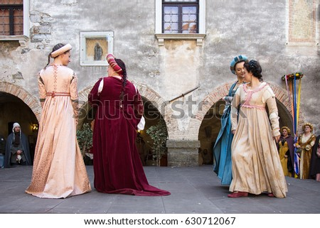 Gorizia, Italy - April 23, 2017: Womans medieval historical dances in medieval clothes on historical reenactment in Gorizia, Italy.