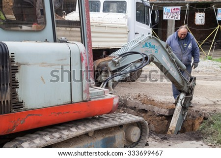 Gorna Oryahovitsa -October 16:Construction Site-Repair Plumbing and construction of additional drainage manholes. Workers and road construction machines of 16 October 2015, Gorna Oryahovitsa, Bulgaria