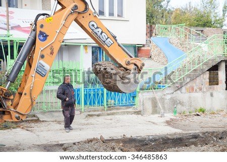 Gorna Oryahovitsa -October 30: Construction Site-Repair Plumbing and construction of additional drainage manholes. Excavator digs of October 30, 2015, Gorna Oryahovitsa, Bulgaria