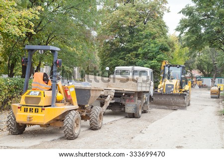 Gorna Oryahovitsa - October 16: Construction Site - Road construction machines for repair and construction of drainage manholes on October 16, 2015, Gorna Oryahovitsa, Bulgaria