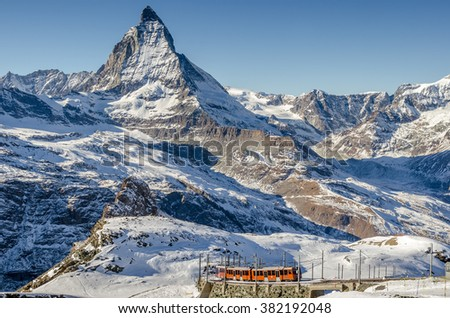 Gornergrat/Switzerland-Dec23 : Train near Gornergrat station over looking Matterhorn peak on Dec23,2015 in Gornergrat / Switzerland. - stock photo