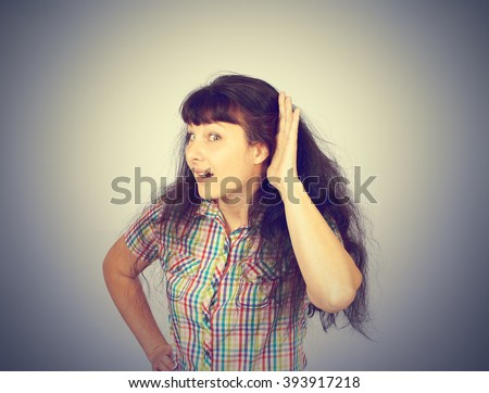 gossip girl eavesdropping with hand to ear. Surprised woman overhearing listening to rumors. - stock photo