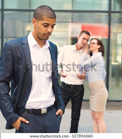 Gossip people in front of their office, handsome businessman portrait and racism gossip out of focus in background. - stock photo