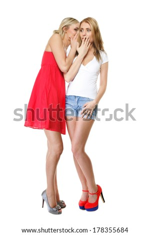 Gossip rumour - two women in full length. Woman telling secrets to your girlfriend, secrets spreading over white background - stock photo