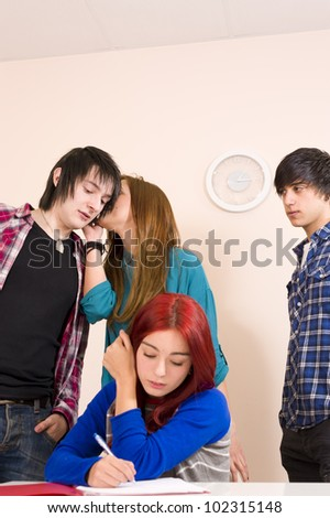 Gossiping about her behind her back - stock photo