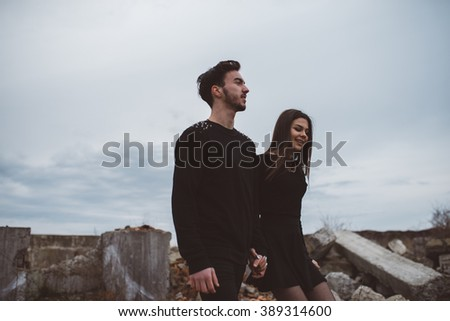 Goth couple outdoors love story. - stock photo