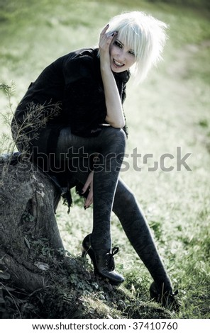 Goth woman outdoors. Freaky concept. - stock photo