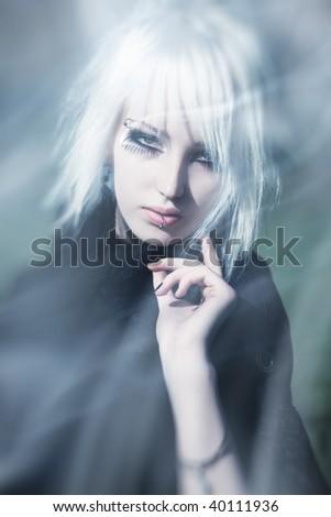 Goth woman surreal portrait. Bright white colors. - stock photo