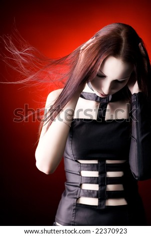 Goth woman with fluttering hair. Shallow dof. - stock photo