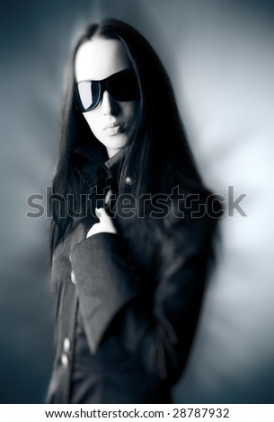 Goth woman with sunglasses. Selective focus effect. - stock photo