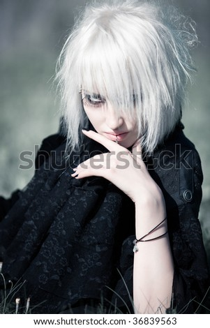 Goth woman with white hair outdoors portrait. - stock photo