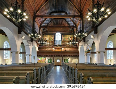 GOTHENBURG, SWEDEN - DECEMBER 17, 2015: Interior of Masthugg Church (Masthuggskyrkan). The church in the national romantic style in Nordic architecture was built in 1914 on the high Masthugget hill. - stock photo