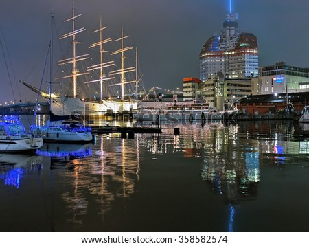 GOTHENBURG, SWEDEN - DECEMBER 15, 2015: Lilla Bommen harbor with the ship Barken Viking in the evening. She was built in 1906 and is reported to be the biggest sailing ship ever built in Scandinavia. - stock photo