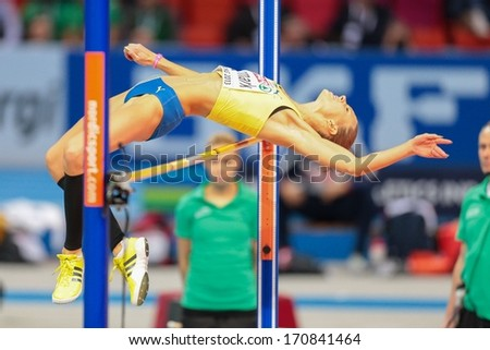 GOTHENBURG, SWEDEN - MARCH 3 Ebba Jungmark (Sweden) places 2nd in the women's high jump finals during the European Athletics Indoor Championship on March 3, 2013 in Gothenburg, Sweden. - stock photo