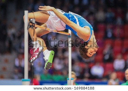 GOTHENBURG, SWEDEN - MARCH 2 Gianmarco Tamberi (Italy) places 5th in the men's high jump finals during the European Athletics Indoor Championship on March 2, 2013 in Gothenburg, Sweden. - stock photo