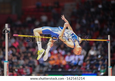 GOTHENBURG, SWEDEN - MARCH 1 Konstadinos Baniotis (Greece) competes in the men's high jump event during the European Athletics Indoor Championship on March 1, 2013 in Gothenburg, Sweden. - stock photo