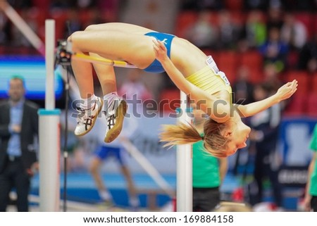 GOTHENBURG, SWEDEN - MARCH 2 My Nordstroem (SWE) competes in the qualification of the women's high jump event during the European Athletics Indoor Championship on March 2, 2013 in Gothenburg, Sweden. - stock photo