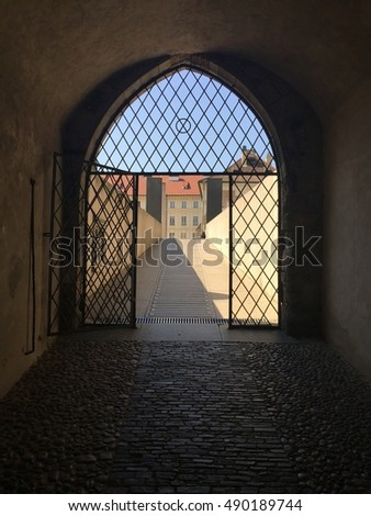 gothic arched gated walkway