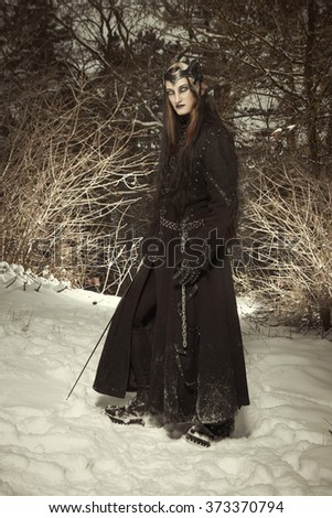 Gothic beauty in winter snowy forest - stock photo