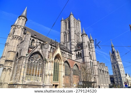Gothic building of St Nicholas church and Belfry of Ghent in the background, Belgium - stock photo