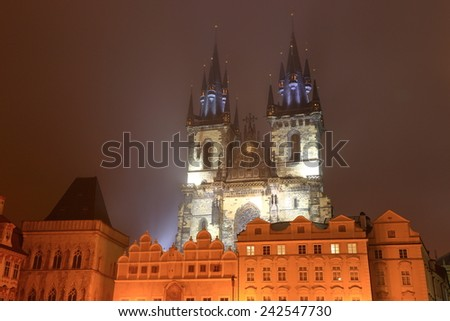Gothic building of the Church of Our Lady before Tyn surrounded by fog at night, Prague Old Town, Czech Republic - stock photo