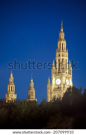 Gothic building tower of Vienna city hall, Rathause, at night, Austria