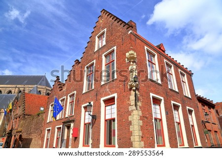 Gothic building with brick facade in historical town of Bruges, Belgium - stock photo