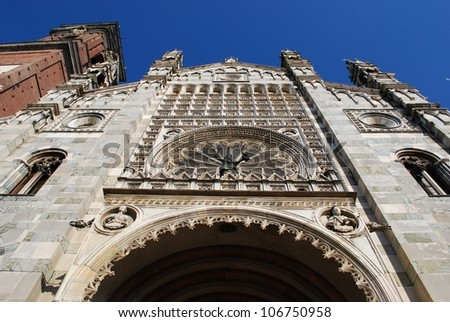 Gothic cathedral facade and tower bell on blue sky, Monza, Lombardy, Italy - stock photo