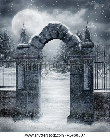 Gothic cemetery gate covered with snow