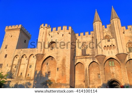 Gothic construction of the Cathedral and Papal Palace (Palais des Papes) at sunset, Avignon, Provence, France - stock photo