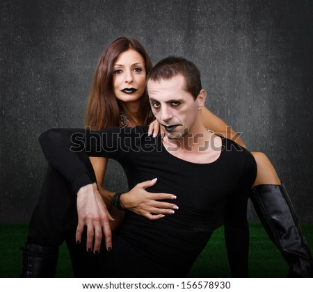 gothic couple embracing
