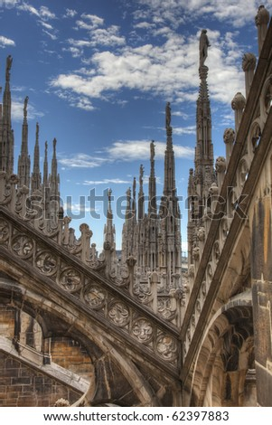 Gothic details and towers on top roof of the milan dome, duomo, in Italy