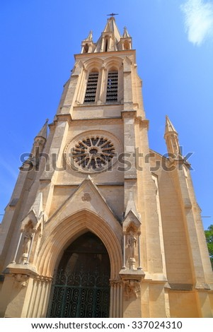 Gothic facade and tower of St Anne church, Montpellier, Languedoc-Roussillon, France - stock photo
