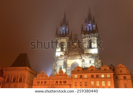 Gothic facade and towers of the Church of Our Lady before Tyn in foggy night, Prague Old Town, Czech Republic - stock photo