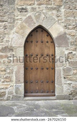 Gothic gate in old church - stock photo