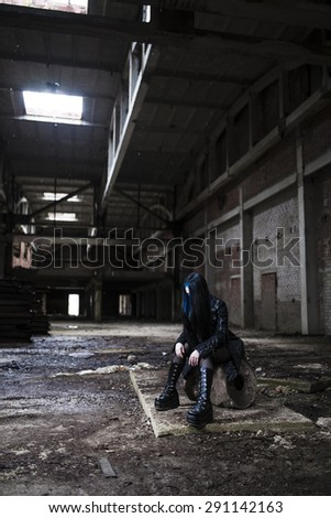 Gothic girl in the image of an abandoned factory