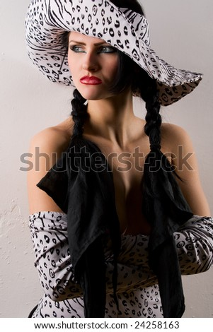 Gothic model wearing retro clothes and hat