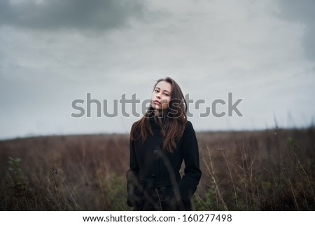 Gothic Photo of beautiful girl in field