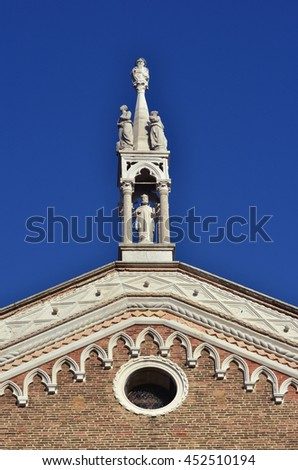 Gothic pinnacle with saints at the top of Ss John and Paul medieval basilica in Venice